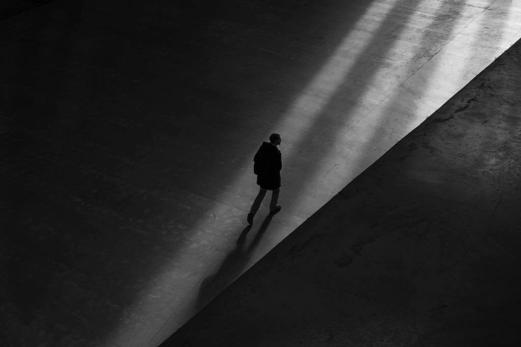 silhouette of a person walking alone