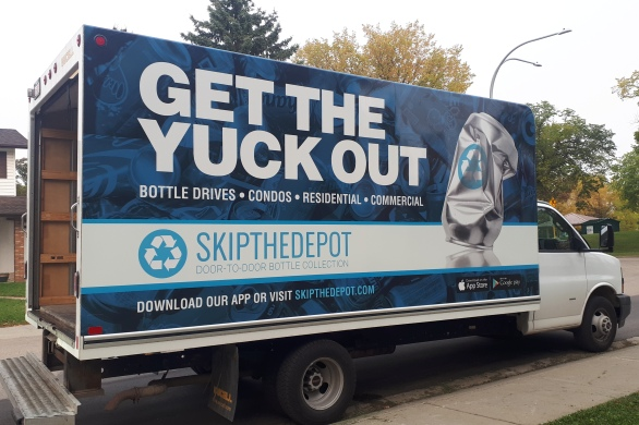 """Box truck with label on the side that says """"Get the Yuck Out, Skip the Depot"""""""