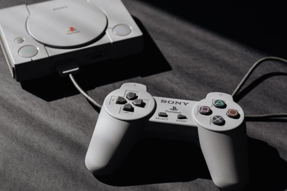Close up view of the original Sony Playstation console and controller.