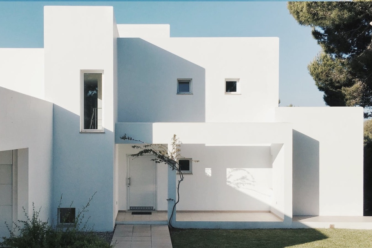 single family house with a pure white cube style architecture
