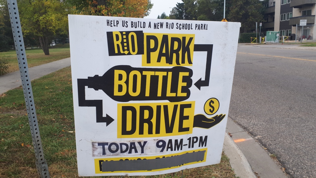"Lawn Sign that says ""Help us Build a New Rio School Park. Rio Park Bottle Drive, Today 9 AM - 1 PM"""
